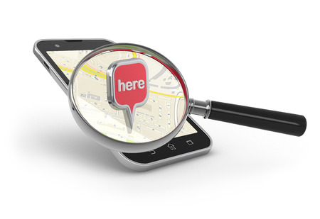Search on the map. Magnifying glass over smartphon on white. photo
