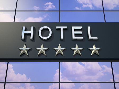 hotel sign: The hotel sign with a five stars on the modern building. Stock Photo