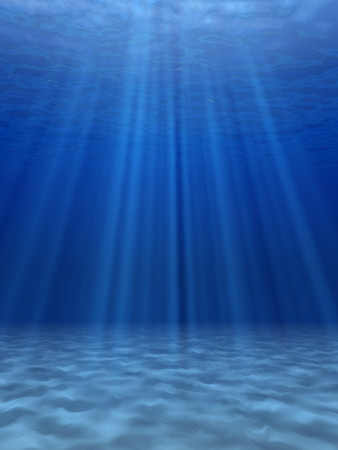 bottom of sea: The suns rays in the blue sea underwater. Stock Photo