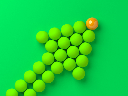 リーダーの前にビジネスやスポーツのリーダーシップの概念図とボールの矢印。
