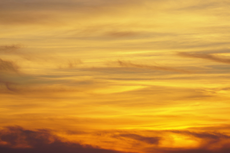 Dramatic and magistic orange cloudy sunset sky. Abstract nature background.