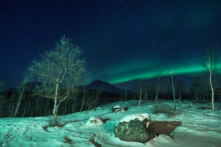 Polar Landscape with Aurora borealis northern lights in the sky. Stock Photo