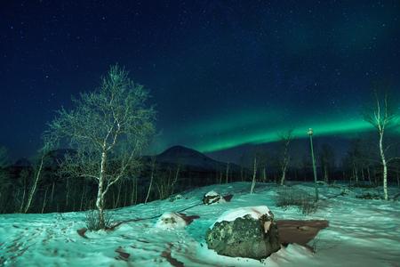 Polar Landscape with Aurora borealis northern lights in the sky. Standard-Bild