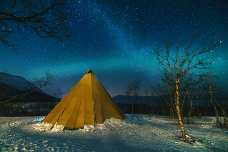 Winter Landscape with Eskimo Tent and Northern Lights in the National Park.