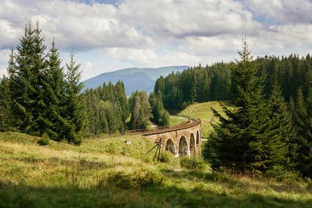 Landscape with old historic railway viaduct bridge in Ukraine.