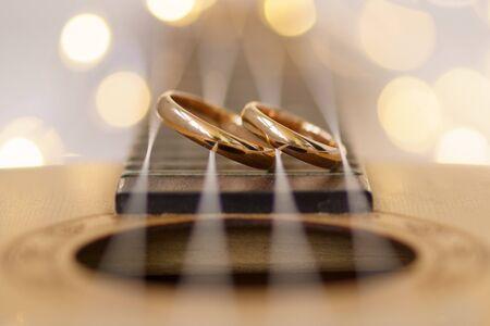 Wedding ring laying on ukulele guitar string. Stok Fotoğraf
