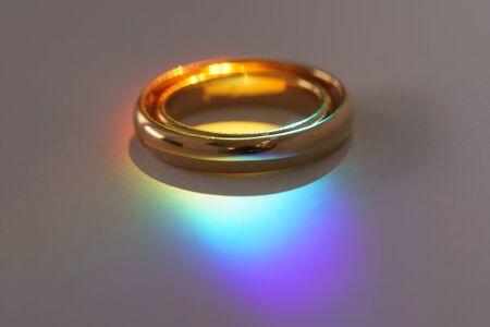Two wedding rings with rainbow light macro.