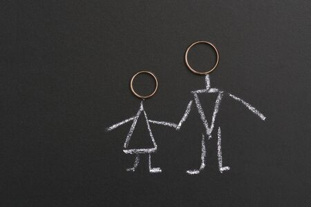 Husband and wife or groom and bride drawn with chalk on a board. Married couple concept.