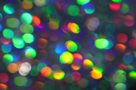 Abstract holographic iridescent gradient color background with numerous colourful bright festive glitter.