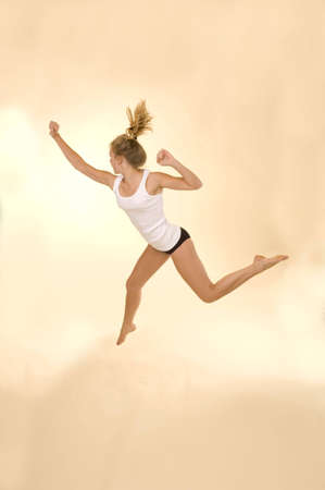 hovering: Woman jumping Stock Photo