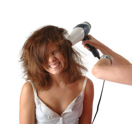Woman with hair dryer Stock Photo - 7504918
