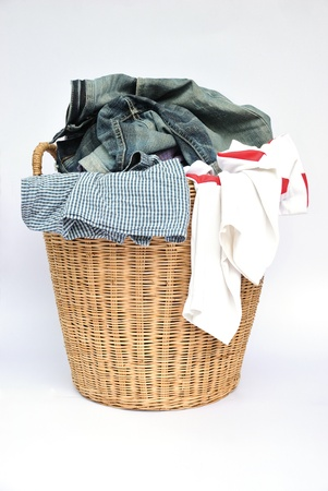 basket  clothes on the white background Stock Photo