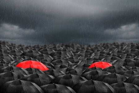 Colorful umbrella in mass of black umbrellas. Zdjęcie Seryjne