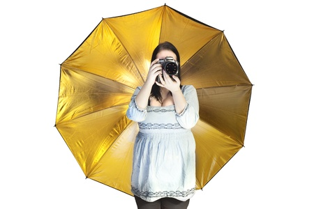 Studio Umbrella in Gold Stock Photo