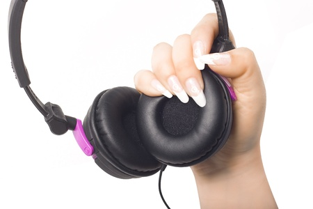 Headphones in womans hand