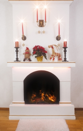 Christmas decorations on a fireplace photo