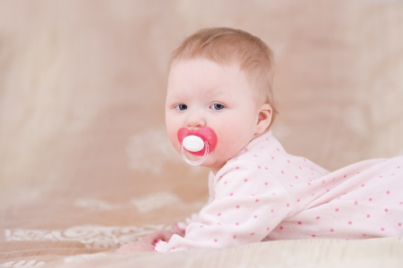 Cute baby with a pacifier