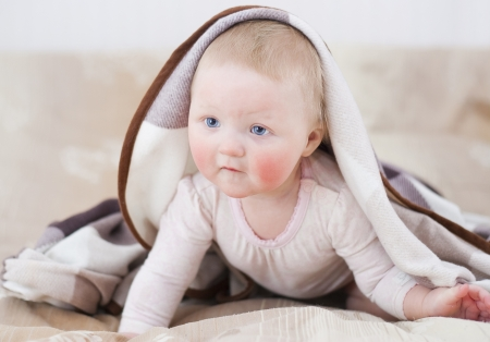 Adorable baby with a blanket