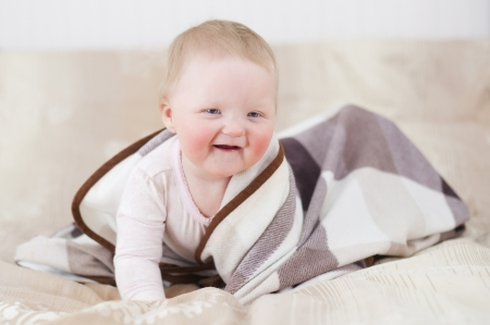 Adorable baby with a blanket Stock Photo - 18748248