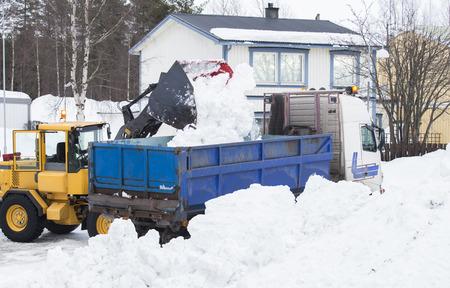 Wheel loader unloading snow Stock Photo
