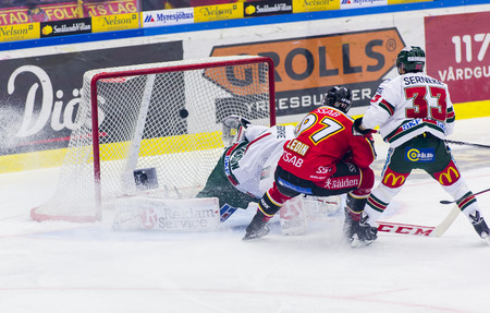Lulea, Sweden - March 18, 2015. Per Ledin (#97 Lulea Hockey) scores! Swedish Hockey League-game, between Lulea Hockey and Frolunda Indians. Editorial