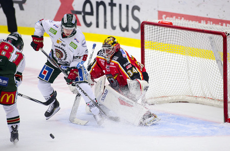 Lulea, Sweden - March 18, 2015. Joel Lassinantti (#34 Lulea Hockey) is having a tough time in the net. Swedish Hockey League-game, between Lulea Hockey and Frolunda Indians.