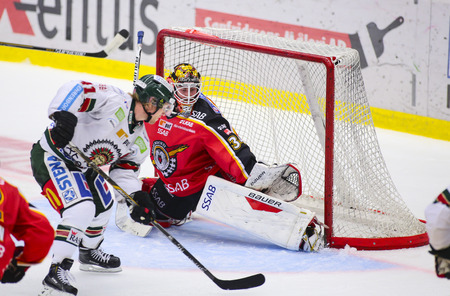 Lulea, Sweden - March 18, 2015. Joel Lassinantti (#34 Lulea Hockey) is ready to make a save. Swedish Hockey League-game, between Lulea Hockey and Frolunda Indians.