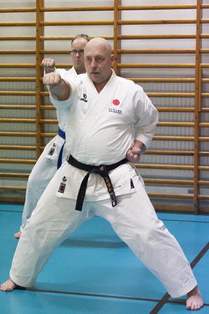 sensei: Skelleftea, Sweden - February 7, 2011. Shotokan Karate practice with Sensei, Robin Nyholm and Tero Nyholm. Self defense techniques - Skelleftehamn Shotokan Karate Klubb.