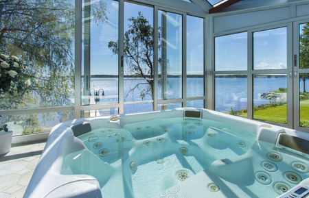 Glassed in jacuzzi by ocean