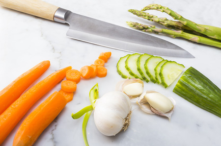 Marble cutting board with vegetables