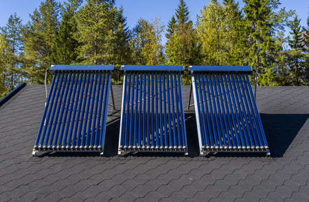 Solar water heater installed on a roof Stock Photo