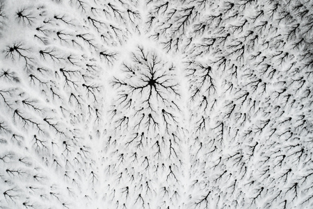 Winter ice cracking landscape - Aerial view - Planet Earth Eco Фото со стока