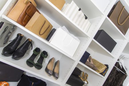 50d2b9634c86 Modern walk in closet with luxury shoes and bags