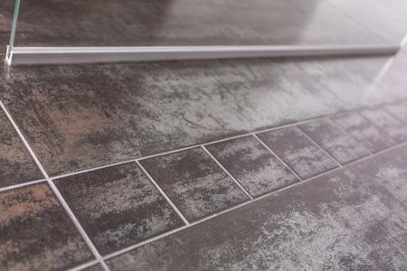Bathroom floor metallic design tiles