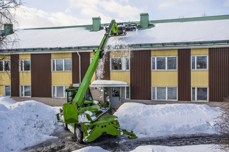 Roof Shoveling - Removing snow from the roof