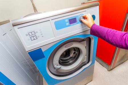 Woman doing laundry - washing machine Reklamní fotografie