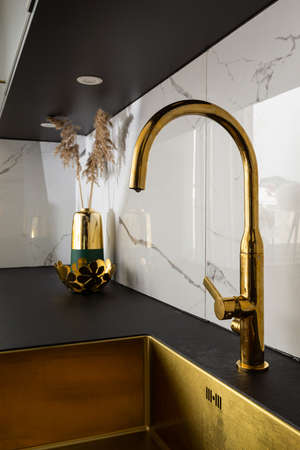 Interior home styling classic and modern kitchen golden water tap