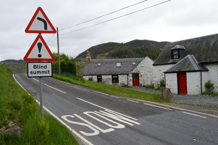 Signs on a road to Scotland Imagens