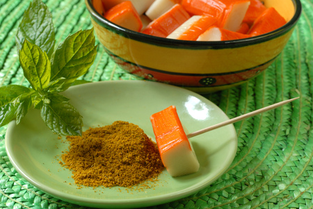 Surimi sticks with curry and mint leaves Stock Photo