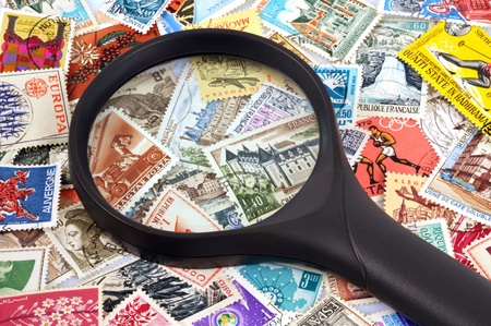 Magnifier posed on stamps
