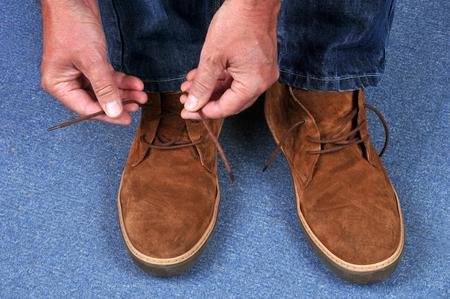 to tie his shoelaces