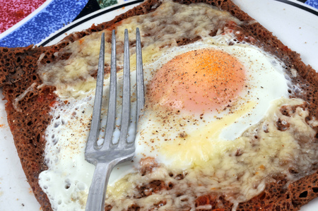 Wheat cake with an egg and grated cheese Stock Photo