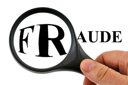 Fraud with magnifying glass Stock Photo