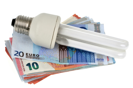 Low consumption bulb placed on banknotes Standard-Bild