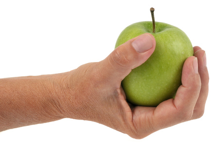 An apple in hand Stock Photo
