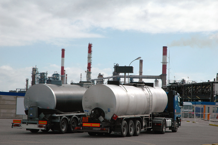Tank trucks in front of a refinery