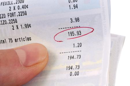 Cash receipt in hand Stock Photo