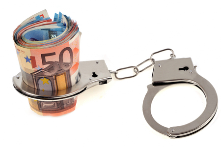 Bunch of handcuffed banknotes Stock Photo