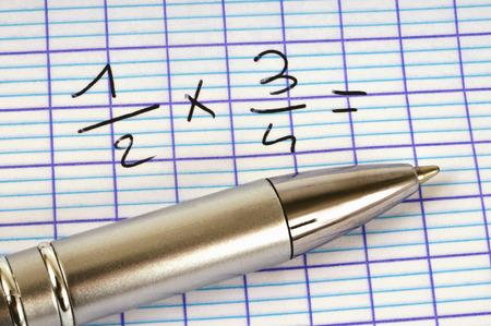 Closeup shot of fraction multiplication formula with ball pen