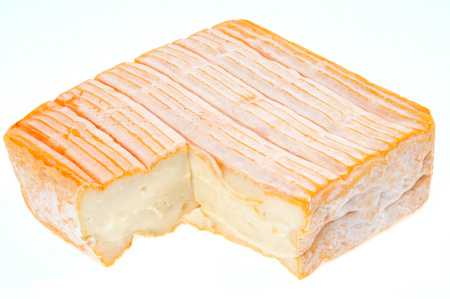 Munster cheese isolated in white